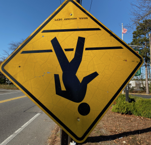 Upside down sign of man walking