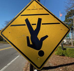 Upside down sign of man walking